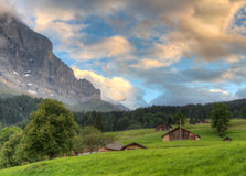 Eiger north face at sunset with huts, Switzerland Stock Photo