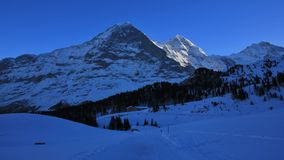 Eiger north face in winter. Famous mountains Eiger, Monch and Ju Stock Image