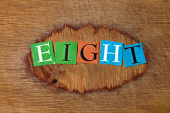 Eight. Text on a wooden board stock photo