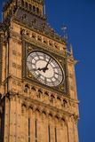 After eight. Clock face of Westminster Clock Tower in evening sunlight stock photo