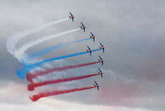 Eight airplanes with color smoke make turn on clou Royalty Free Stock Images