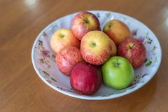 Eight of apple on a beautiful plate stock images