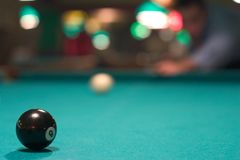 Eight Ball. Black eight ball on pool table Stock Photo