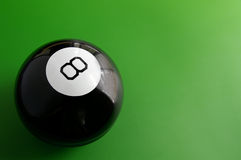 Eight ball. Closeup of a billiard 8 ball on a pool table Stock Photography