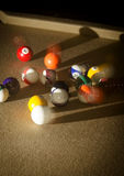 Eight ball break. Balls in motion at the time of due ball striking a racked set of billiard balls Royalty Free Stock Photos