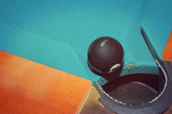 Eight Ball at the Hole. On Pool Table Royalty Free Stock Photo