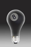 Eight ball in light bulb Stock Image
