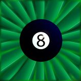 Eight Ball Over Green. A typical eight snooker ball over a green material background Stock Photo