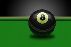 Eight ball on table Royalty Free Stock Photo