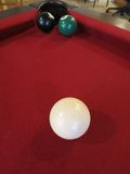Eight Ball Tough Shot -- The 8 ball blocks the hole. A tough shot in pool: the 8 ball blocks the hole as someone lines up a shot at a green solid ball Stock Images