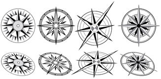 Eight Black and White Compasses Stock Images