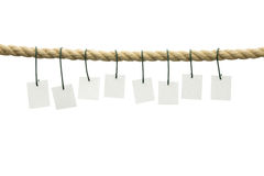 Eight blank cards hanging off a rope Royalty Free Stock Images