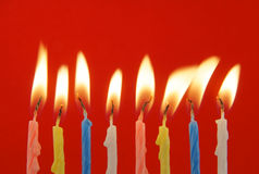 Eight burning candles Stock Images