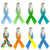 Eight candles with ribbon two. Eight candles with awareness ribbons wrapped around candle on white background. Clipping path included Stock Photos