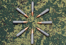 Eight cartridges on camouflage background bullets oriented inside Royalty Free Stock Photo