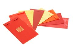 Eight Chinese new year red packets. Eight assorted Chinese new year red packets arranged on white background Royalty Free Stock Photo