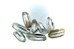 Eight Clear Quartz Crystal points. A group of eight clear quartz crystal points on white surface, not isolated Stock Image