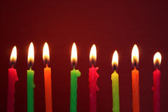 Eight colorful birthday candles Stock Photos