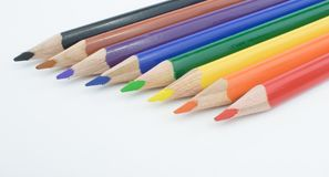 Eight Diagonal Rainbow Colored Pencils. Eight rainbow colored pencils diagonal Stock Photography