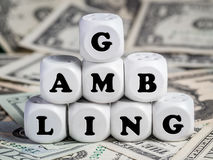 Eight dice spelling GAMBLING Stock Photos