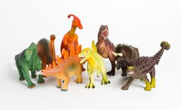 Eight different models of dinosaurs on white Royalty Free Stock Photo