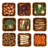 Eight different vegetables in wooden basket Royalty Free Stock Image