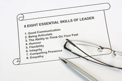 Eight essential skills of leader. Concept with pen and eyeglass in whte background Stock Photography