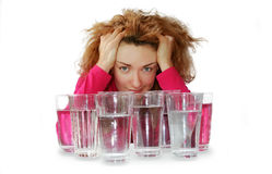 Eight glasses of water. And a girl stock photos