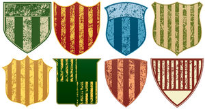 Eight Grunge Striped Shields Royalty Free Stock Photography