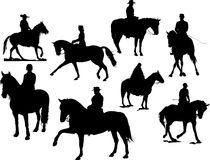 Eight  horse rider silhouettes Stock Photos