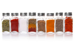 Eight jars of spices stock photos