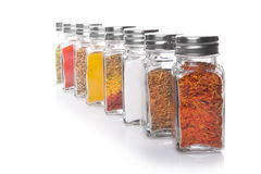 Eight jars of spices Royalty Free Stock Images