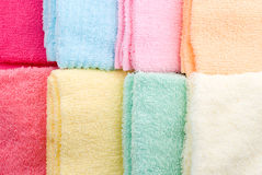 Eight laid towels. Background and texture of eight multi color towels laid side by side Royalty Free Stock Photos