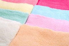 Eight laid towels. Background of eight multi color towels laid side by side Stock Photography