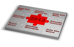 Eight languages said happy new year in 2012. Over a puzzle Stock Photos