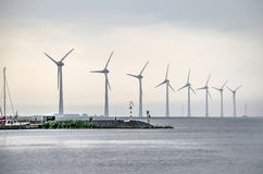 Eight large wind turbines royalty free stock photography