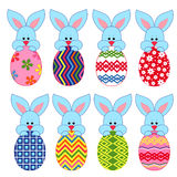 Eight little Bunnies with Easter eggs Royalty Free Stock Images