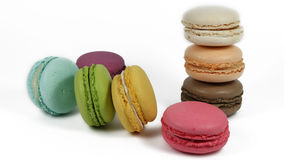 Eight macarons - eight colours. Colourful french macarons: yellow, green, blue, pink and others Royalty Free Stock Images