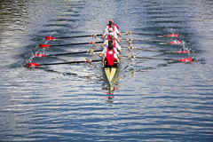 Eight men rowing Stock Images