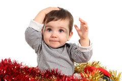 Eight months baby inside a box. With christmas ornaments in a white background Stock Photography