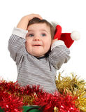 Eight months baby inside a box. Posing with a Santa hat in a white background Stock Image