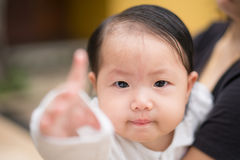 Eight months old baby asian girl Royalty Free Stock Images