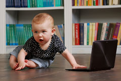Eight months old todler baby playing with tablet pc on the floor Royalty Free Stock Photo