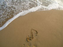 Eight note on beach Royalty Free Stock Images