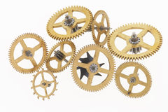 Eight old golden cogwheels. Many old gold-coloured little cogwheels are connected Stock Image