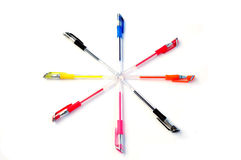 Eight pens in the shape of wind-rose on white. Stock Photography