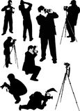 Eight photographer silhouettes Stock Images