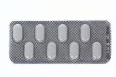 Eight pills package. Package of eight pills isolated over white background Stock Photos