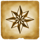 Eight point star on old paper Royalty Free Stock Photography