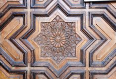 Eight pointed star, close up of a carved wooden door stock photography
